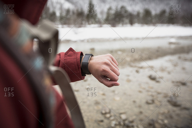 Close-up of woman with smartwatch in winter
