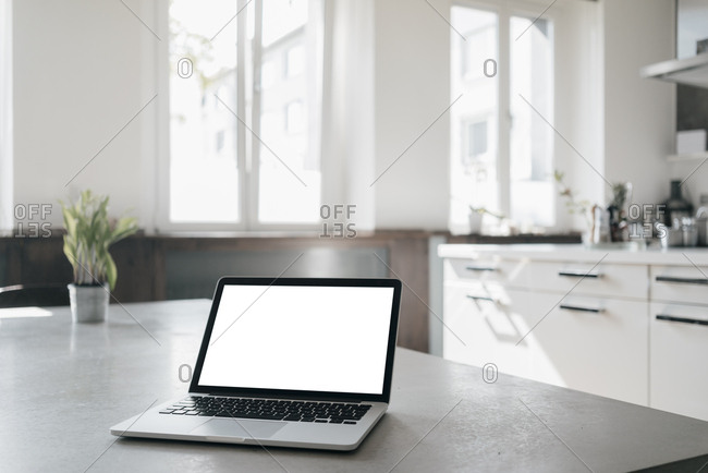Laptop on table in a loft