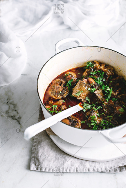 Oxtail casserole on a rustic kitchen table