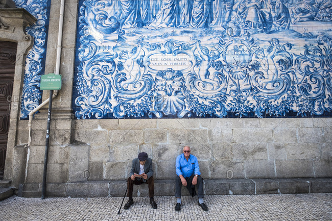 Porto, Portugal - September 21, 2017: Mosaics on the outside of the Capela das Almas Chapel of Souls in the center of the city