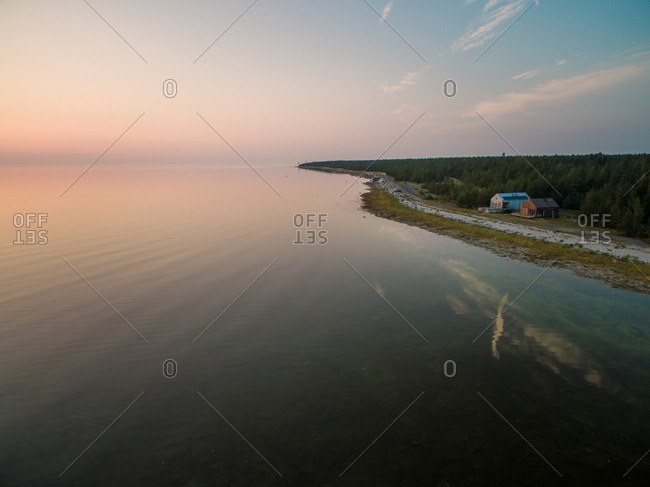VORMSI ISLAND, ESTONIA - 2016-07-26 : Aerial view of two houses on the beach of Vormsi island at sunset in Estonia