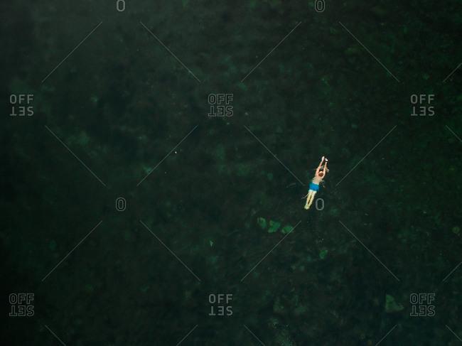 Aerial view of a boy swimming in the baltic sea in Estonia