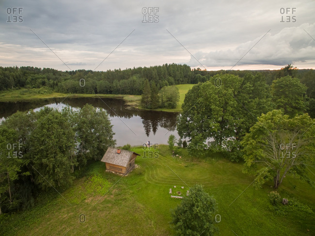 LUHTE, ESTONIA - 2016-07-29 : Aerial view of a small house close to a lake in Estonia