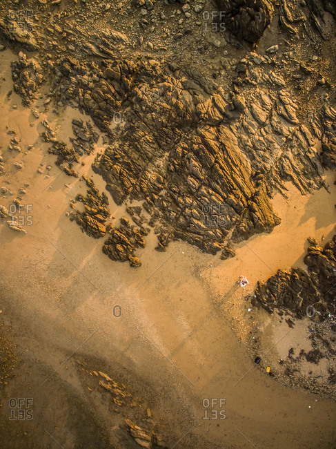 Selfie aerial view of droners on a rocky sandy beach in Koh Lanta Island, Thailand