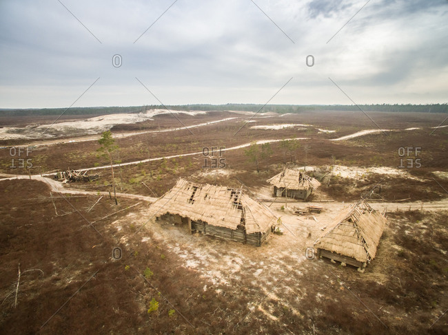 ESTONIA - 2017-04-02 : Aerial view of straw huts in the deserted countryside landscape of Estonia