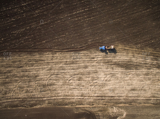 Aerial view of a tractor working on the farmland in Estonia
