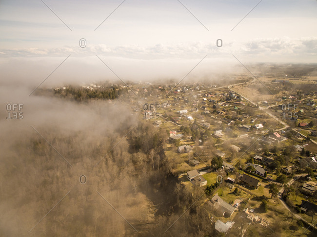 Aerial view of a village thought the mist in Estonia