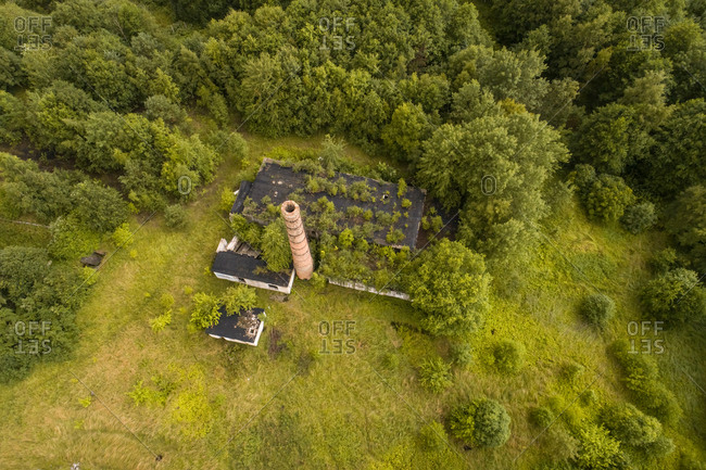 Aerial view of a industrial ruins covered by green vegetation in Estonia