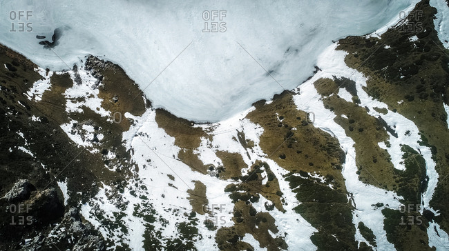 Aerial view of a frozen mountain lake in Asturias, northern Spain