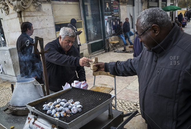 March 28, 2016: Roasted chestnuts for sale on the streets of Lisbon, Portugal.