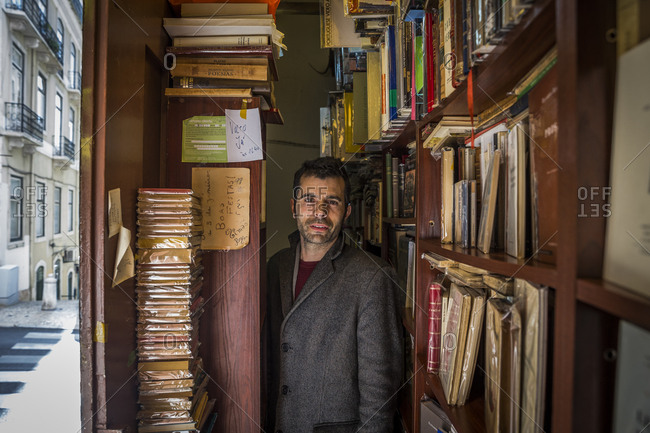 March 31, 2016: Simao Carneiro, owner of what is possibly the smallest bookshop in the world, in Lisbon, Portugal.