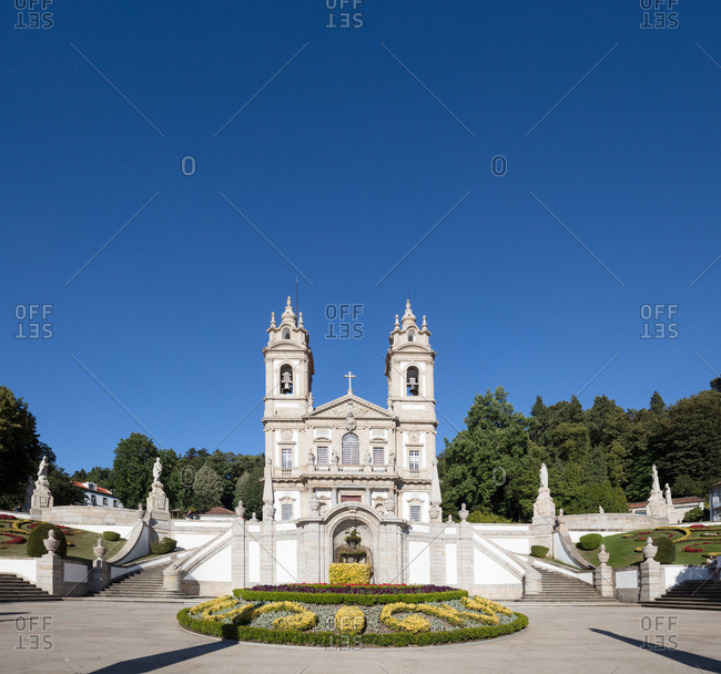 Landscaped cathedral courtyard on sunny day