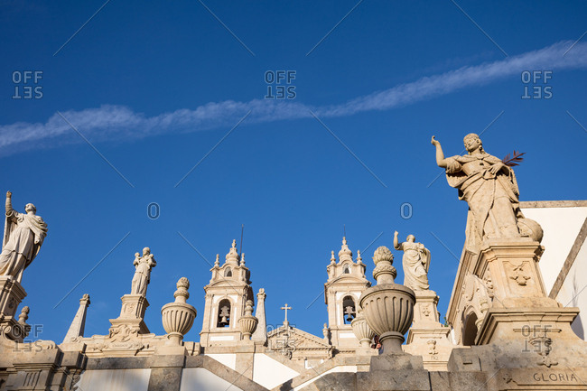Statues on Portuguese church steps at golden hour