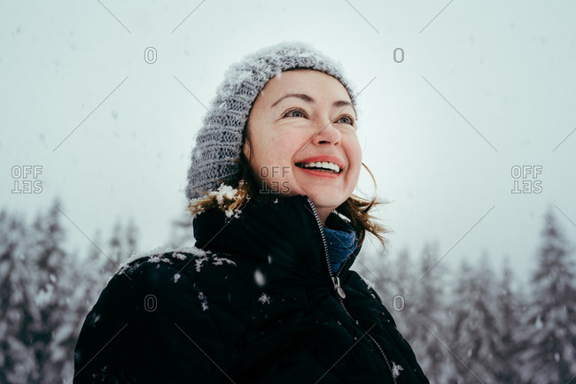 Woman smiling in falling snow
