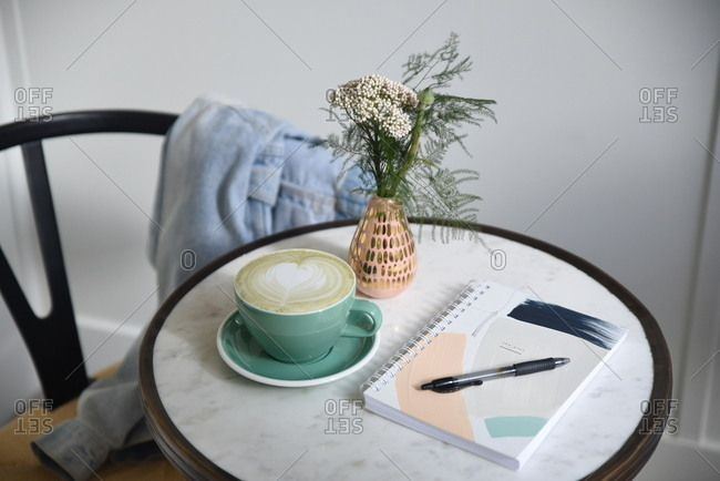 Morning workspace at pretty cafe table