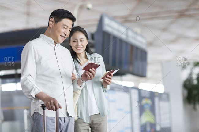 Mature Chinese couple at airport