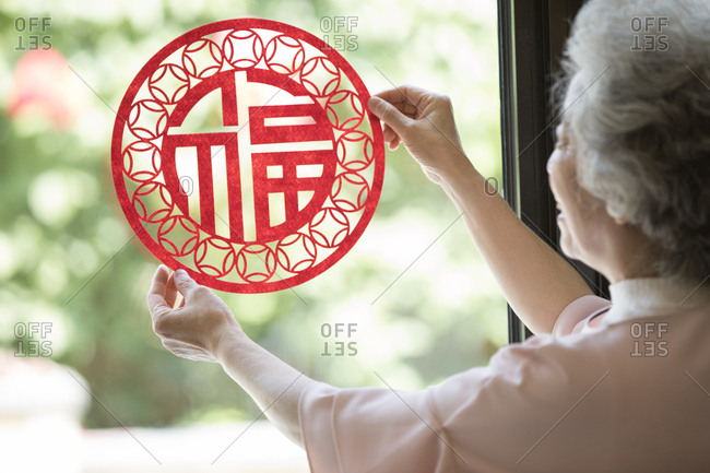 Senior woman with Chinese New Year paper-cut