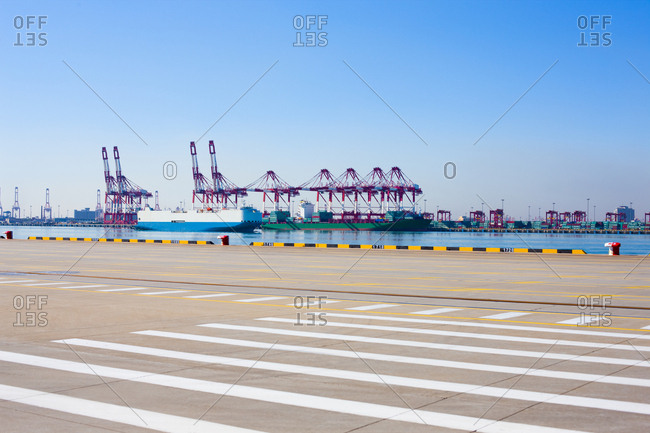 Cranes and cargo ships on the shipping dock