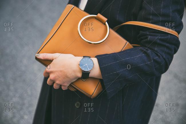 Street fashion portrait detail of professional woman's leather purse