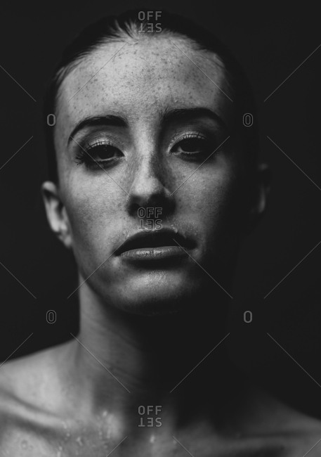 Black and white portrait of model with wet face