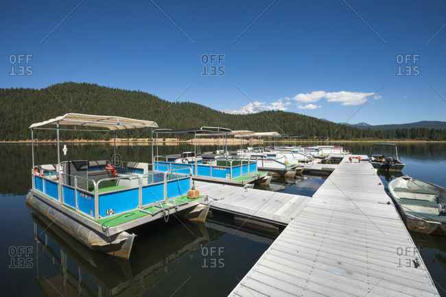 California, USA - September 13, 2016: Boats docked on Lake Siskiyou on a beautiful summer day with Mount Shasta in the background, California