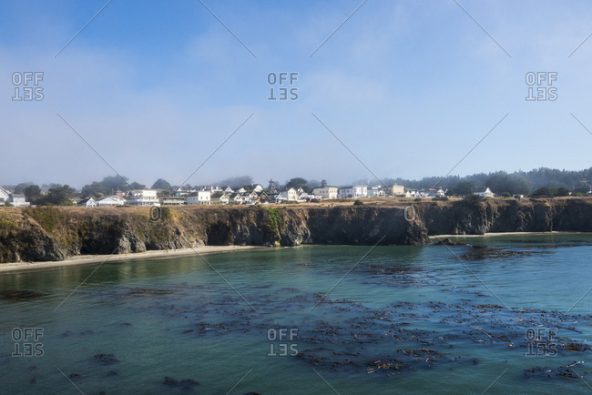 The town of Mendocino along the Pacific Ocean on a beautiful day with breaking fog, California