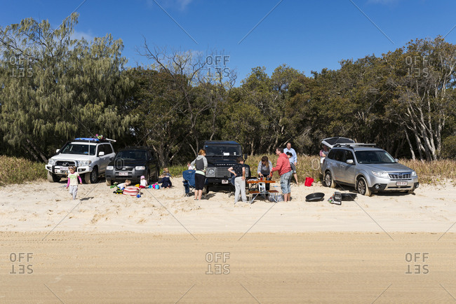 Cooloola, Queensland, Australia - July 19, 2015: Group of people having a beach picnic at Double Island Point