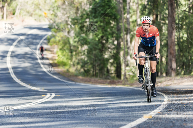 Sunshine Coast, Queensland, Australia - July 14, 2017: Cyclist in Velothon race on country road