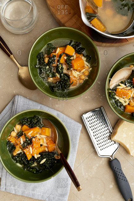 Homemade kale and orzo soup with squash