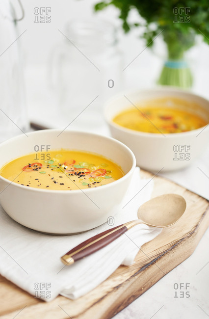Bowl of homemade spicy carrot soup served with a spoon