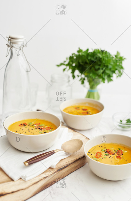 Bowls of spicy carrot soup