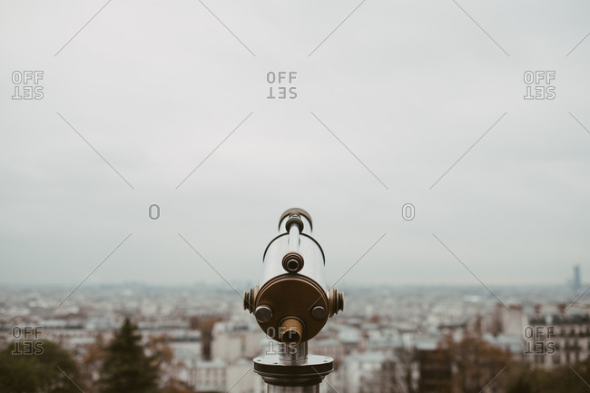 Telescope overlooking the city of Paris
