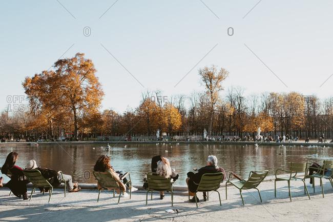 People relaxing at the Pond in Jardin des Tuileries, Paris