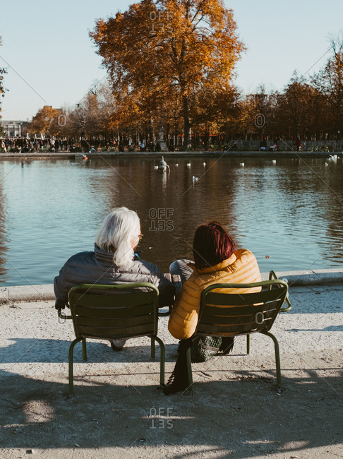 Couple relaxing  at the Pond in Jardin des Tuileries, Paris