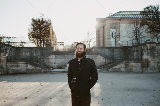 Man with film camera at Jardin des Tuileries, Paris