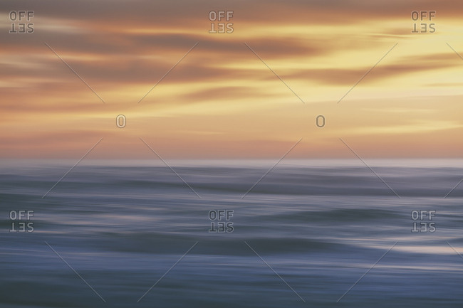 Seascape with cloudy sky at sunset