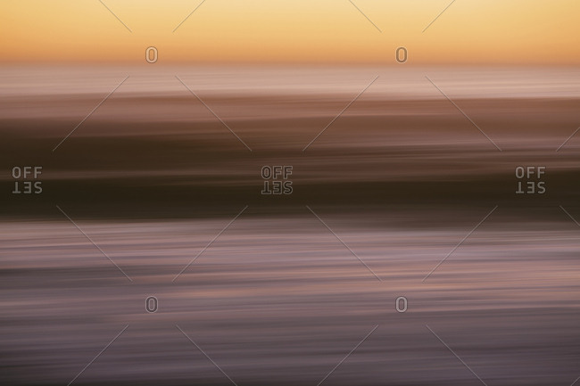 Abstract seascape with horizon over ocean at dusk