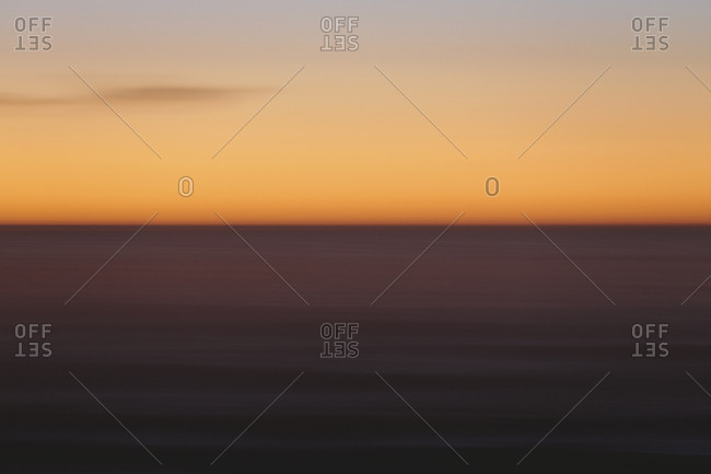 Seascape with horizon over ocean at dusk