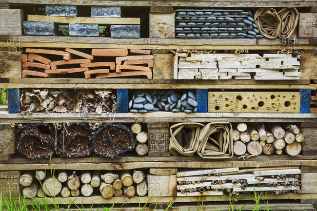 Close up of large bug house with several layers of different materials