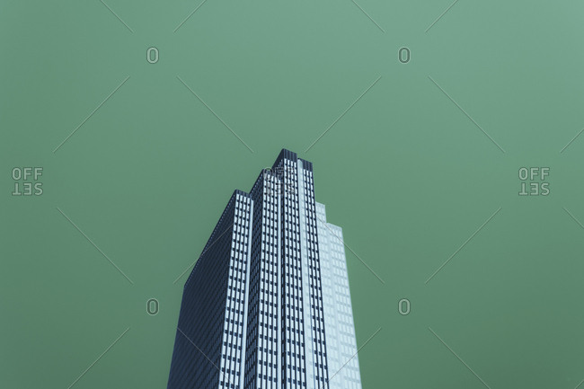 Low angle abstract of modern office building extending towards sky