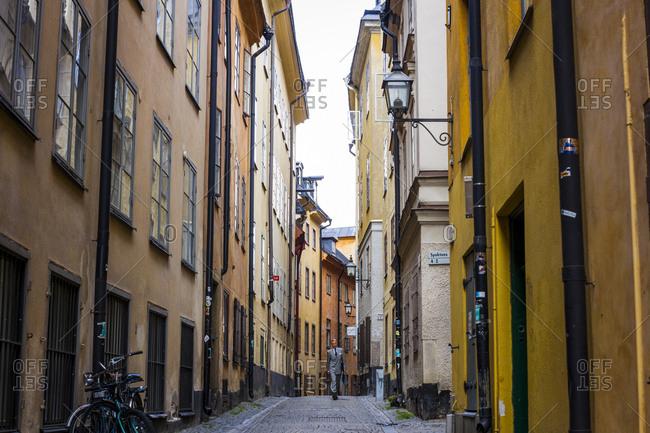 Stockholm, Sweden - July 15, 2014: A businessman walks through Gamla Stan