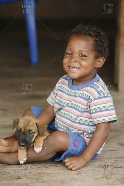 May 4, 2006: Boy Holding Puppy; Tasbapauni, Nicaragua