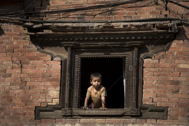 March 26, 2007: Child Leaning Out Of Window; Ancient City Of Bhaktapur, Nepal