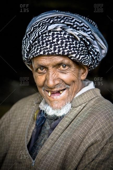 June 5, 2007: Portrait Of Man With Lost Teeth Smiling At Camera; Lidderwat, Kashmir, India