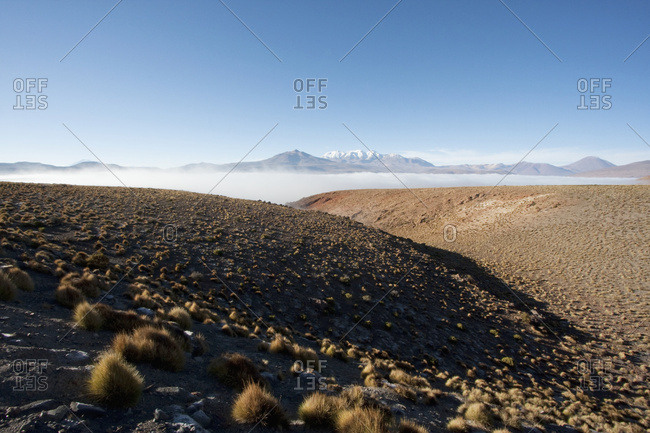 February 21, 2008: Andean Peaks & Salar De Alconcha Salt Pan Covered By Fog, Antofagasta Region, Chile