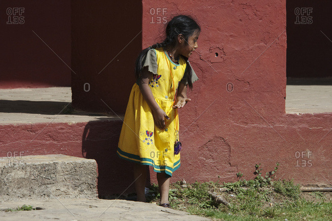 March 12, 2005: Maya Girl Playing In The Courtyard Of The Santo Domingo Church, San Cristobel De Las Casas, Chiapas, Mexico