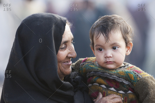 January 0, 1900: Woman Carrying A Baby In A Relief Camp After The 8 October 2005 Earthquake, Muzaffarabad, Azad Kashmir, Pakistan