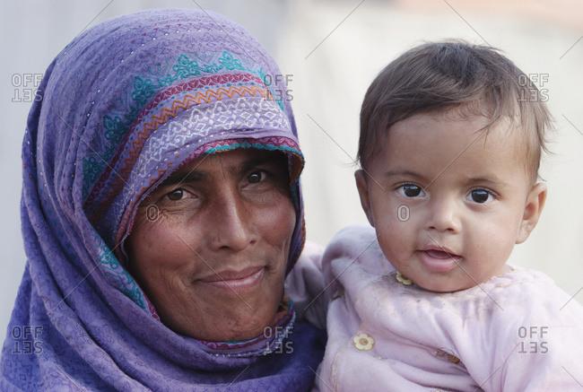 January 0, 1900: Woman Carrying A Baby After The 8 October 2005 Earthquake, Muzaffarabad, Azad Kashmir, Pakistan