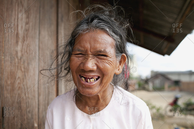 April 10, 2012: A Hill Tribe Vietnamese Woman With No Teeth Laughing; Dalat, Vietnam