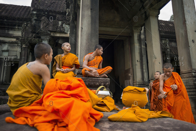 August 9, 2014: A Group Of Young Monks Hang Out At Angkor Wat; Siem Reap, Cambodia